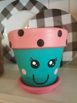 Hand painted 6-inch terracotta face pots. Cute planter with